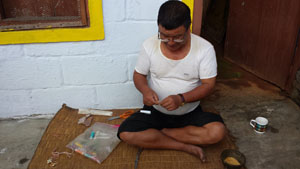 Magar Shaman making amulet