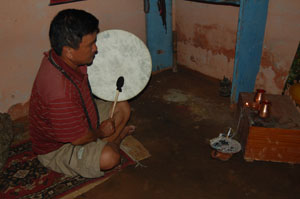 Magar shaman doing puja