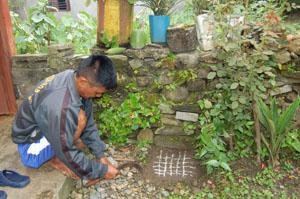 Magar shaman preparing for puja